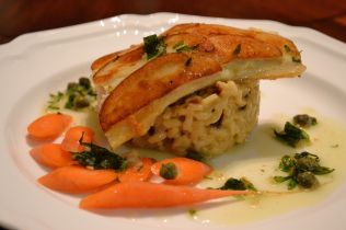Halibut encrusted with potato slices with tarragon sauce