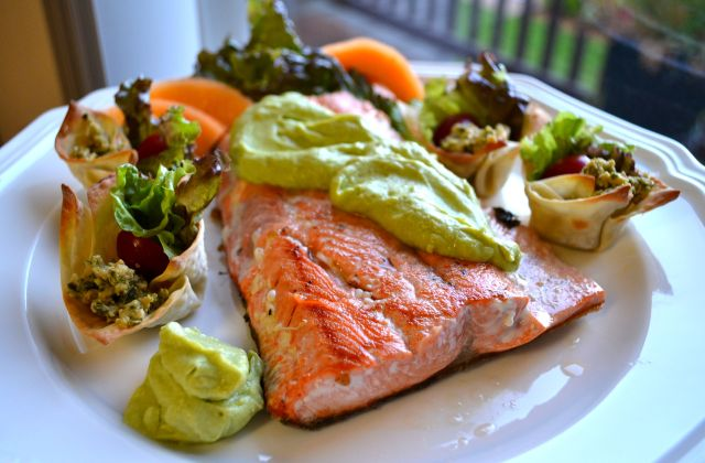 Avocado chevre spread on poached salmon; rocket salad wontons