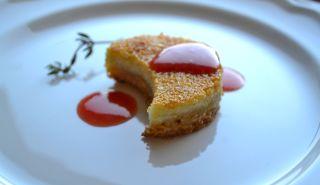 cheesecake bite with raspberry collis