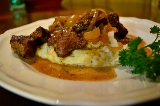 Roasted garlic beef stew on creamed potatoes.